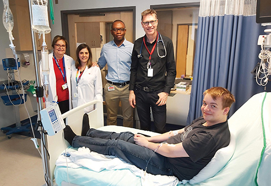 MUHC patient Samuel Gauthier, Dr. John Mitchell and team