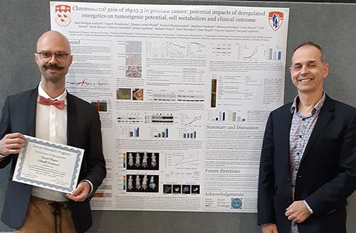 One of the first place winners at the Cancer Research Program (CRP) Research Day, May 3, 2019