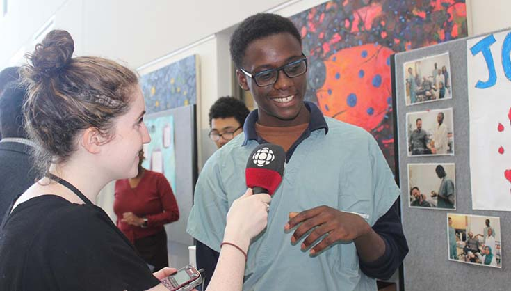 Rayan Primus from John Grant High School discusses his wound project with a CBC reporter
