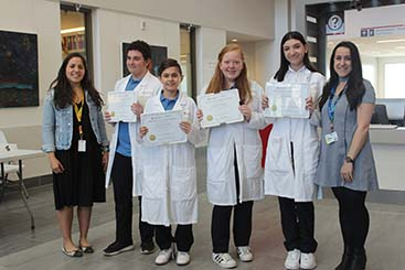 Lester B. Pearson High School students proudly display Certificates of Merit provided by their mentors in Dr. Burnier's laboratory: Paulina Garcia de Alba Graue and Christina Mastromonaco regarding their Ophthalmology project.