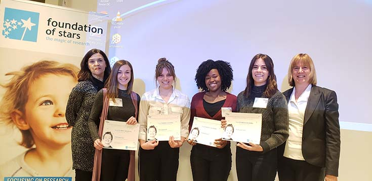 Presentation of prizes at the third Congrès provincial de la recherche mère-enfant at the Research Institute of the MUHC, May 17, 2019, left to right: Sylviane Chatel (Foundation of Stars); prize-winners Melissa Bélanger, Virginie Gaudreault, Benjhyna Daniel, and Marie-Julie Allard; and Josée Saint-Pierre (director, Foundation of Stars)